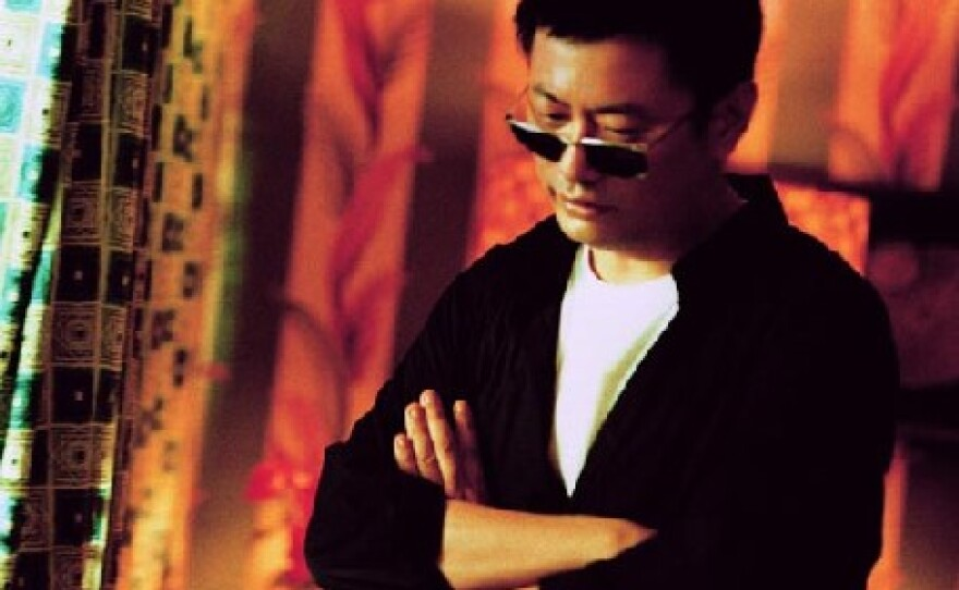 "Filmmaker Wong Kar-Wai on the set of ""In the Mood for Love."""