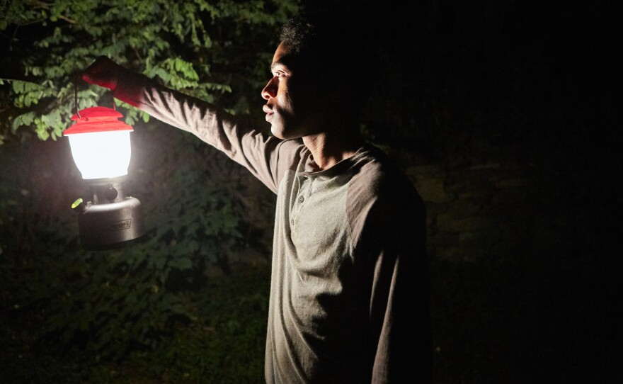"""Travis (Kelvin Harrison, Jr.) goes against his father's instructions and ventures outside at night in """"It Comes At Night."""""""