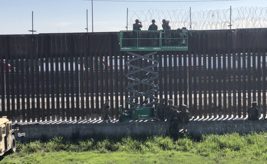 Marines string concertina wire at the Otay Mesa Port of Entry, Nov. 16, 2018