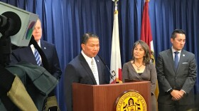 Vic Bianes, San Diego Public Utilities Director, speaks at a news conference about customers being overcharged on their water bills, Feb. 15, 2018. Also in the photo is Mayor Kevin Faulconer (left), City Councilmembers Lorie Zapf and Chris Cate (right).