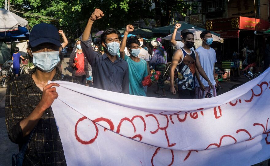 Protesters march during a demonstration against the military coup in Yangon, Myanmar, on Sunday.