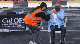 Dr. Tomas Aragon, State Public Health Officer and California Department of Public Health Director, takes part in a vaccination event at the RingCentral Coliseum in Oakland, Calif., on Thursday, March 11, 2021, to highlight the new one-dose Janssen COVID-19 vaccine by Johnson & Johnson.