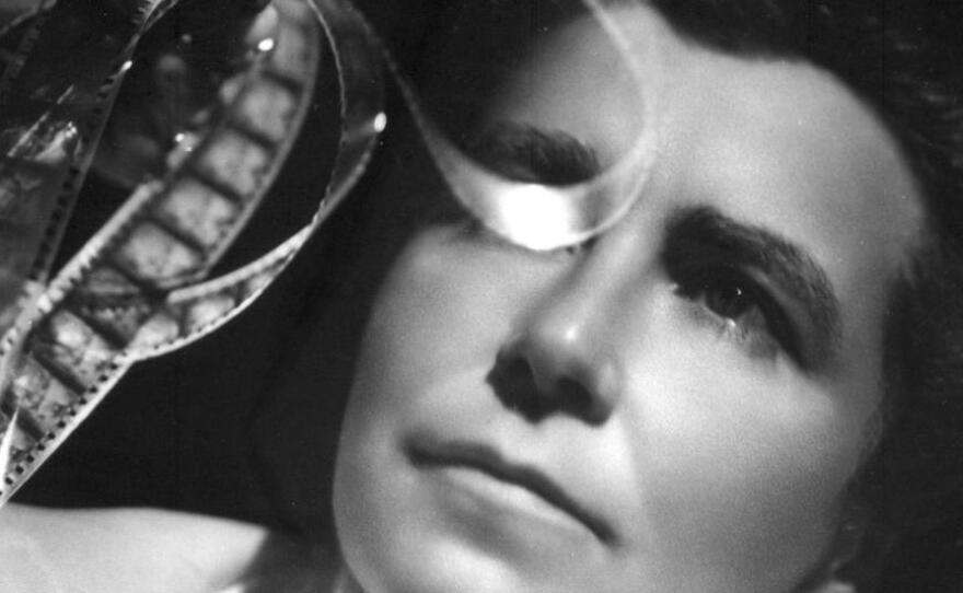 Director Dorothy Arzner examining some film.