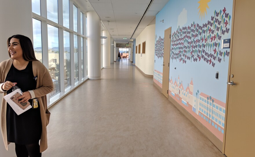 Wendy Mejia, a program coordinator for Rady Children's Hospital's Center for Healthier Communities, stands in a hallway at the medical facility's main campus in Kearny Mesa, Dec. 17, 2018.