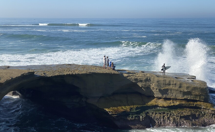 People watching the high surf at Sunset Cliffs in San Diego County. Jan. 9, 2021.