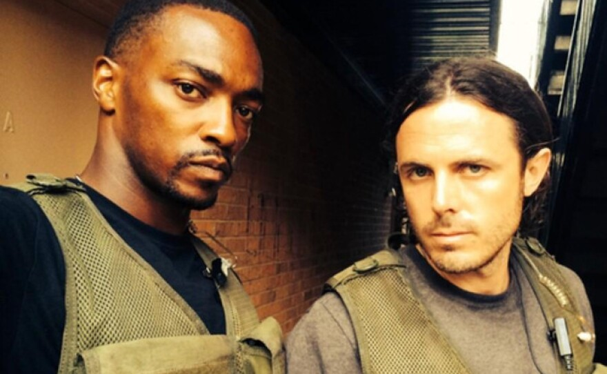 """Anthony Mackie and Casey Affleck play cops who are not thrilled to be working together in the gritty thriller, """"Triple 9."""""""
