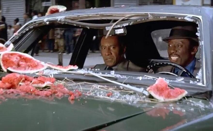"""Raymond St. Jacques and Godfrey Cambridge play Coffin Ed and Gravedigger Jones, a pair of unorthodox cops in Ossie Davis' """"Cotton Comes to Harlem"""" (1970)."""