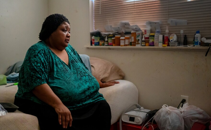 Wilma Banks, who lives in the neighborhood of New Orleans East, sits on her bed next to her nebulizer and CPAP machine. In the aftermath of Hurricane Ida, when much of New Orleans was left without power, she wasn't able to power up the medical devices and had only her limited supply of inhalers to widen her airways.