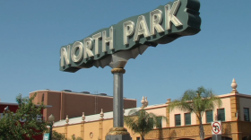The North Park neighborhood sign stands at University Avenue and 29th Street, June 28, 2016.
