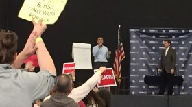 Rep. Darrell Issa stands onstage at the Junior Seau Recreation Center in Oceanside to take questions from constituents at a town hall meeting on March 11, 2017.