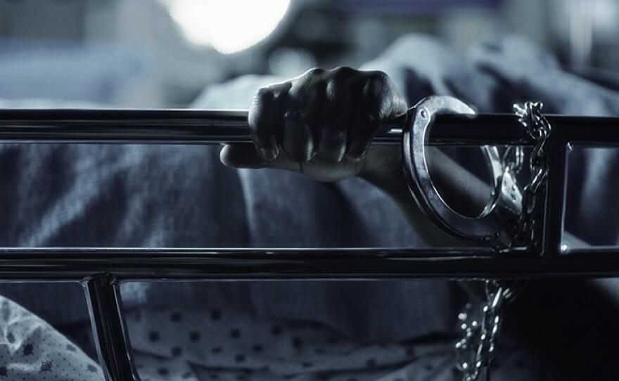 Woman handcuffed to gurney