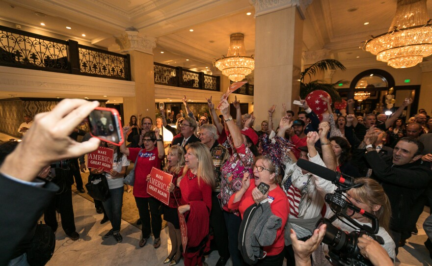 San Diegans at a Republican watch party at the U.S. Grant Hotel react to the news that Donald Trump won the presidency, Nov. 8, 2016.