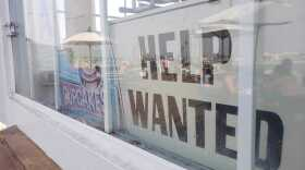 A help wanted sign at the Tin Fish restaurant on Imperial Beach Pier, Sept. 12, 2020.