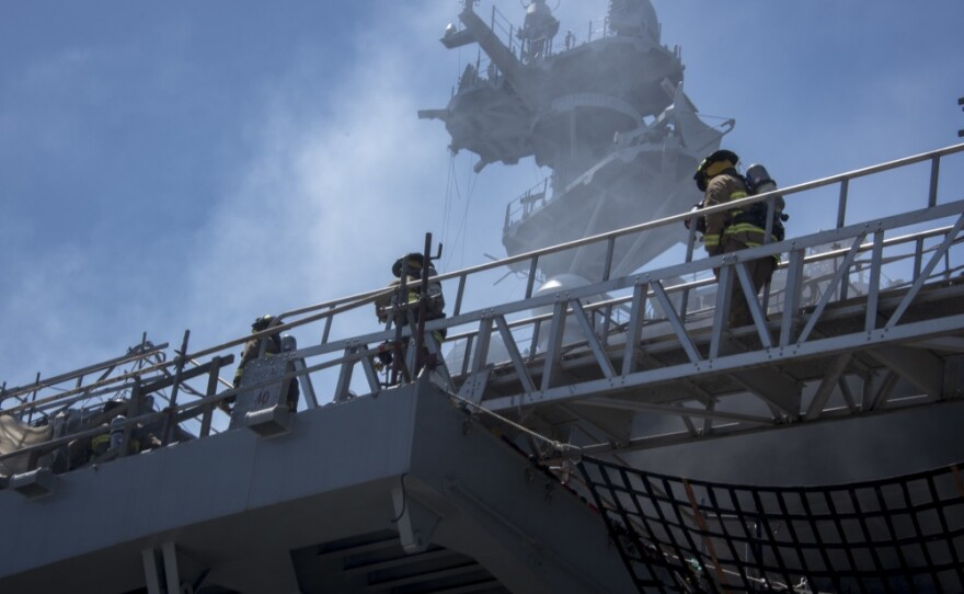 Sailors and Federal Fire Department San Diego firefighters combat a fire aboard the amphibious assault ship USS Bonhomme Richard (LHD 6) at Naval Base San Diego, July 14, 2020.