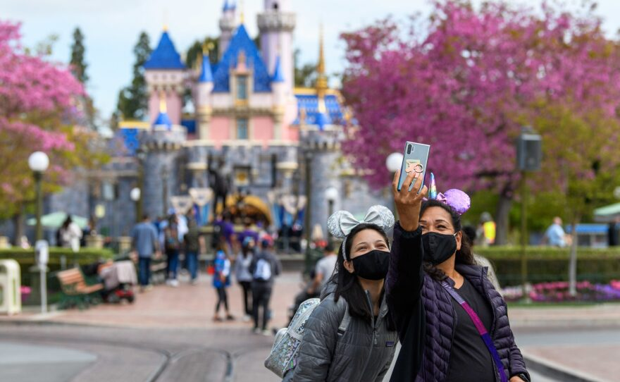 Visitors at Disneyland after it reopened to the public on April 30, 2021.