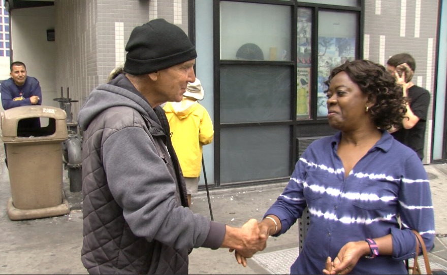 Agnes Cole (right), a caseworker with Father Joe's Villages, shakes hands with Charles Lins, who was homeless until Cole helped place him into permanent housing, June 22, 2017.