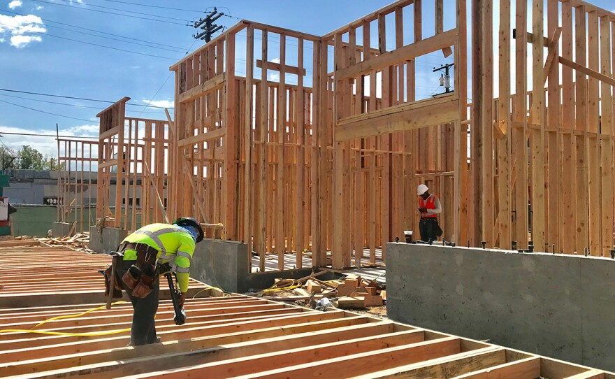 Construction crews work on a 24-unit apartment building in North Park, July 23, 2019.