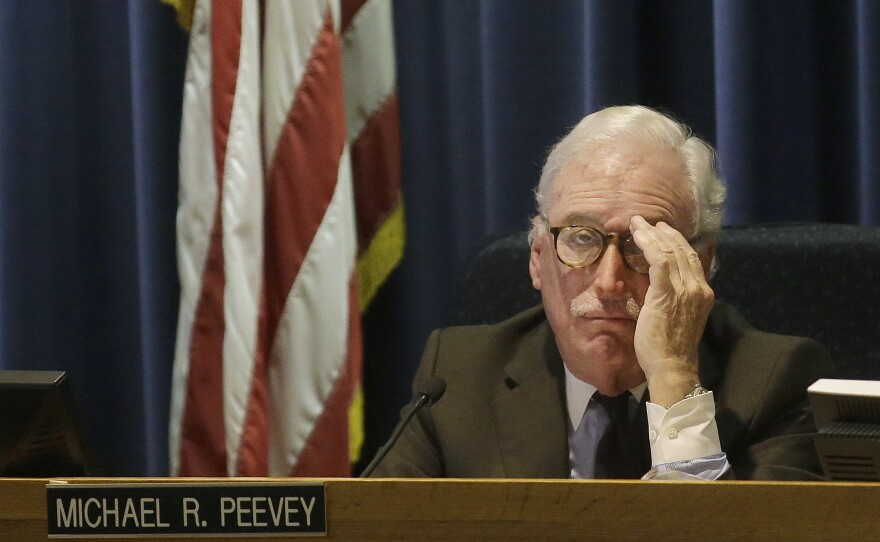Michael Peevey listens to public comment during a meeting in San Francisco, Dec. 18, 2014.