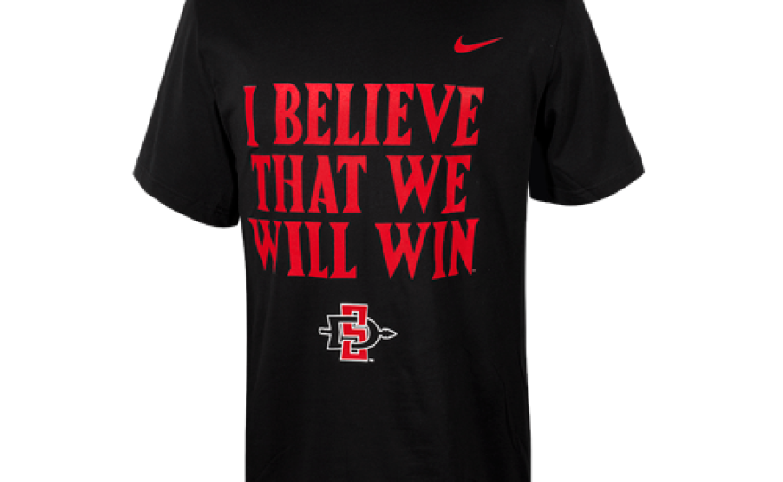 """A T-shirt emblazoned with the chant, """"I Believe That We Will Win!"""" is sold by Atzec Shops Ltd., a nonprofit operating at San Diego State University."""