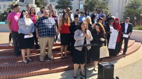 Community advocacy groups gather outside the County of San Diego building in downtown, April 10, 2018.