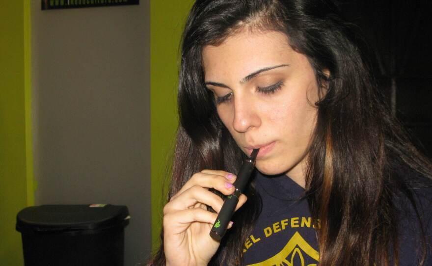 Nikki Esquibel, 19, has a medical prescription for marijuana. She uses a vaporizer pen around her neighborhood in Los Angeles.