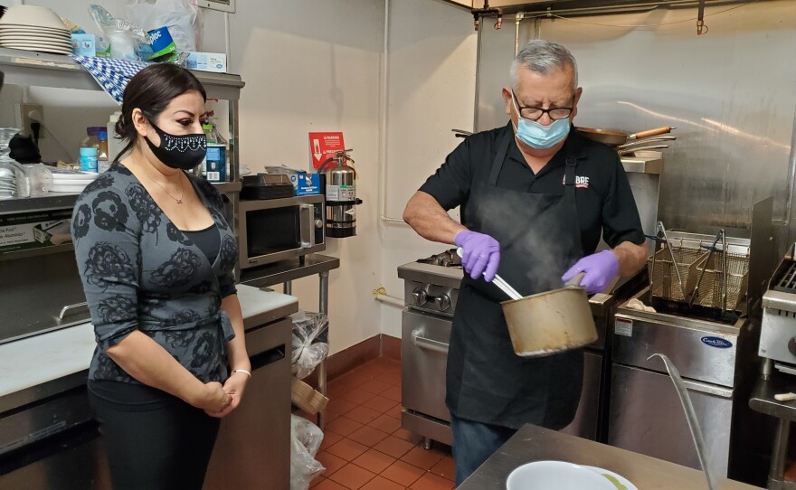 Tania Corona and her father work in the kitchen at their restaurant Lumbre Mexican Seafood in Imperial Beach, April 26, 2021.