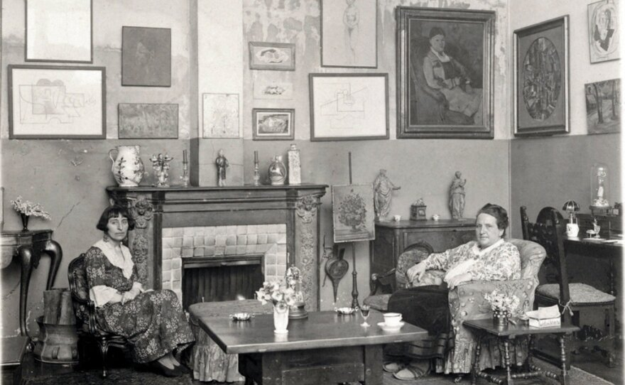 Gertrude Stein, right, and Alice B. Toklas in 1922 in their art-filled apartment in Paris.
