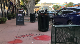 """The word """"love"""" and images of hearts have been spray painted over a swastika by community members in Hillcrest, Oct. 3, 2020."""