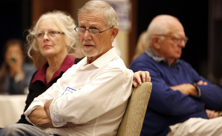 Voters watch election returns come in at San Diego's Democratic headquarters at the Westin Gaslamp Hotel, Nov. 8, 2016.