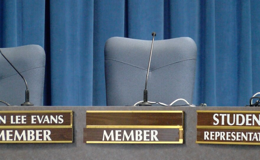 The seat where Marne Foster sat during San Diego Unified School Board meetings before resigning sits empty, Feb. 16, 2016.