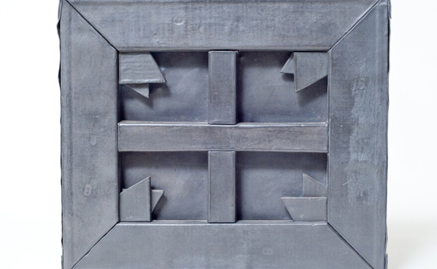 """Russell Baldwin, """"Sculpture Of A Painting, Variation #4,"""" 1980, lead over wood, 8-1/8"""" x  9-1/4"""". Private Collection. Photo: Chip Morton. This variation from Baldwin's series is not displayed in the library but shares the same materials and methods as Variations #1 and #2, which can be seen on the eighth floor of the library."""