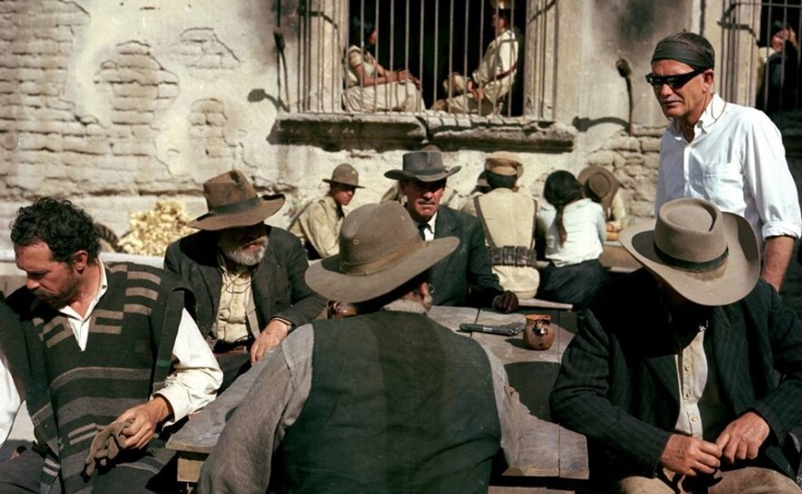"""Director Sam Peckinpah (far right) on the set of """"The Wild Bunch."""""""