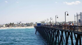 People fishing off Imperial Beach pier in this file photo dated Sept. 5, 2020.