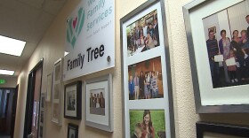 A hallway at Walden Family Services, a foster care agency in San Diego, with framed pictures of foster and adoptive families. June 1, 2021.