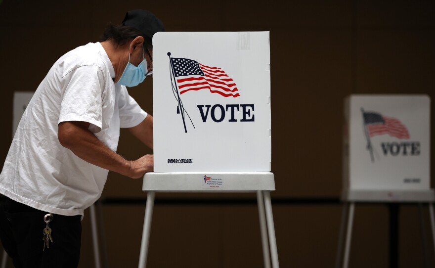 A voter fills out his ballot while early voting at the Santa Clara County registrar of voters office on October 13, 2020 in San Jose, California.