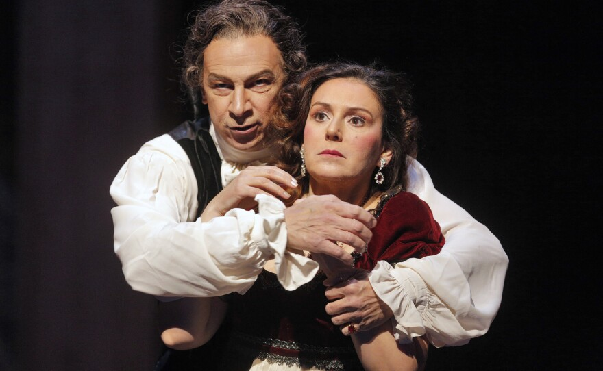 """Bass-baritone Greer Grimsley is Scarpia and soprano Alexia Voulgaridou is Tosca in the new San Diego Opera production of Puccini's """"Tosca."""""""