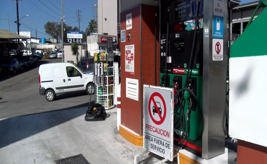 """An """"out of service"""" sign stands at a Tijuana gas station, Jan. 6, 2017."""