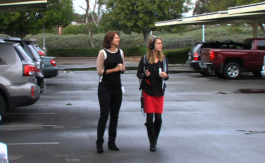 Nicole Capretz, the director of Climate Action Campaign, shows KPBS reporter Claire Trageser the solar trees in the parking lot of Kyocera, Jan. 4, 2016.