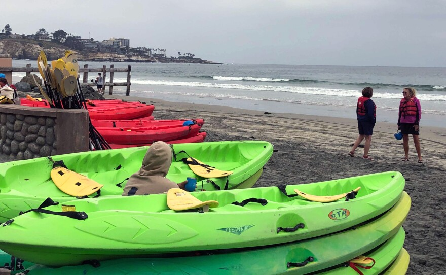 Two women waiting for their kayak tour in La Jolla to start, May , 2021.