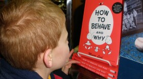 """Brokton Harris reads a booked called """"How to Behave and Why"""" in this childhood photo."""