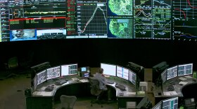 Electrical power flow and conditions are monitored at the California Independent System Operator grid control center in Folsom, Calif., Aug. 18, 2017.
