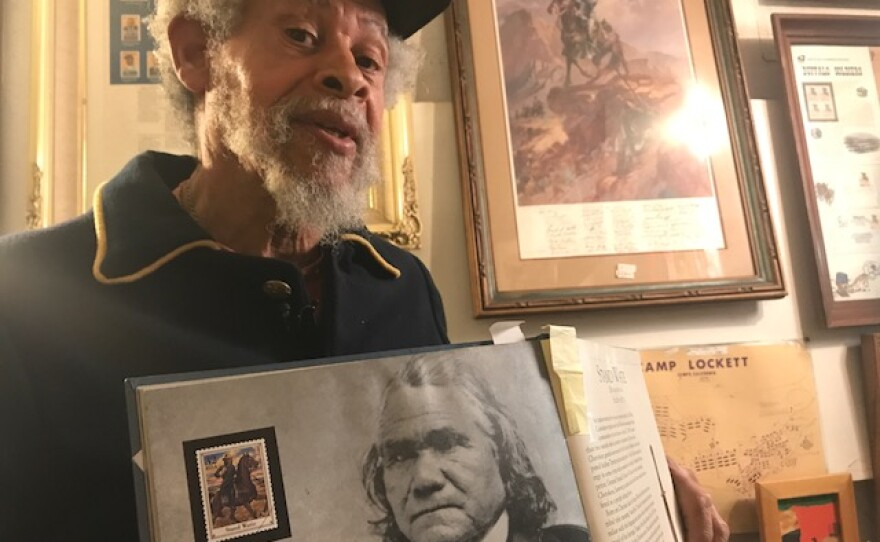 Professor Chuck Ambers, Museum Educational Curator at the African Museum in Old Town, gives a history lesson on Juneteenth. June 19, 2018.