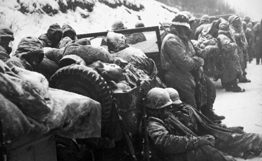 U.S. Marines rest on the road during their withdrawal from the Chosin Reservoir, North Korea. Nov. 29 - Dec. 3, 1950.