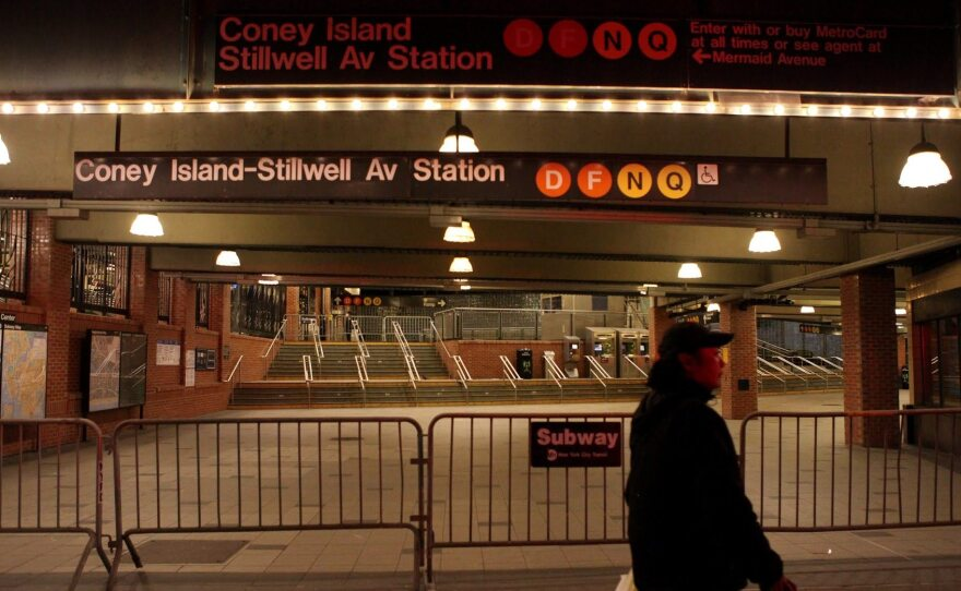 Early Wednesday, some of the 472 stations across the city were closed with gates, while others, like this in Coney Island in Brooklyn, were blocked with barricades.