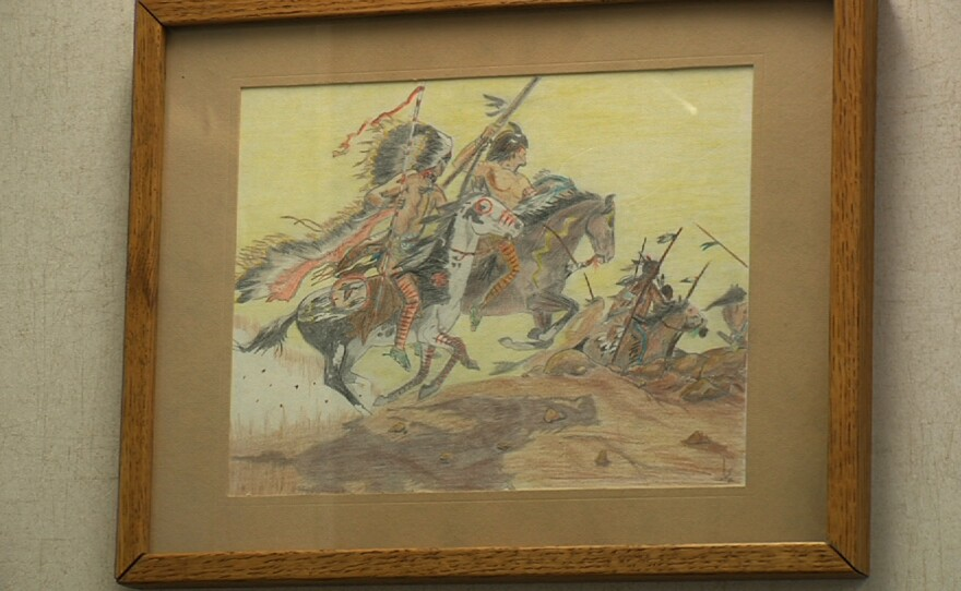 A drawing of Indian warriors done by City Councilman Scott Sherman hangs on the wall of his City Council office, Jan. 14, 2015.