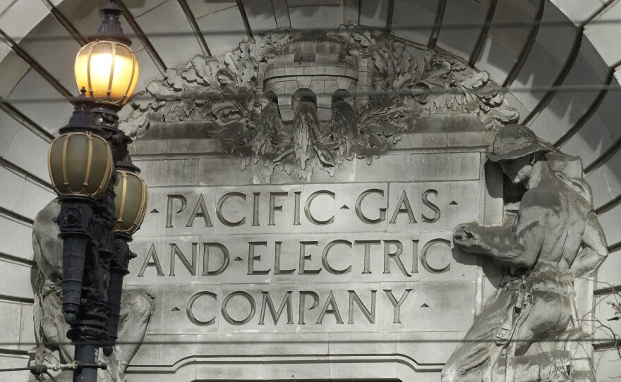 A Pacific Gas & Electric sign is shown outside of a PG&E building in San Francisco, Oct. 10, 2019.