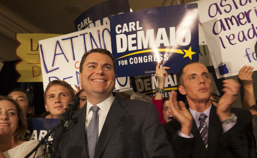 Carl DeMaio and his partner Johnathan Hale surrounded by DeMaio's supporters on election night at the U.S. Grant in downtown San Diego, Nov. 4, 2014.