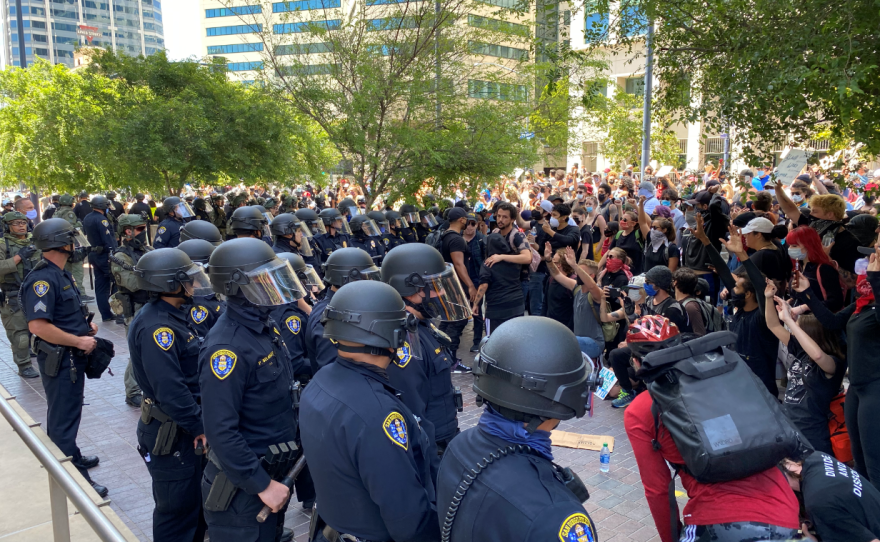 Police and protesters face off in downtown San Diego, May 31, 2020.