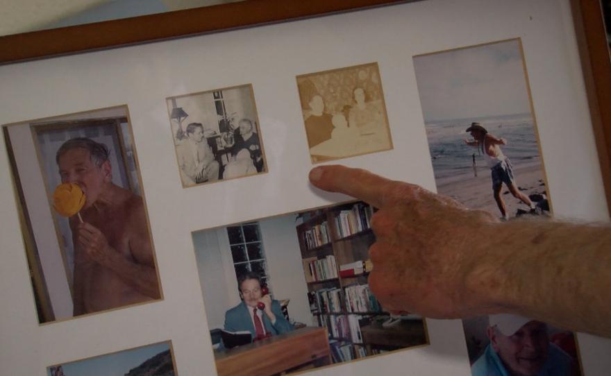 Robert Bettinger gestures toward a frame holding old photos of himself, June 22, 2016.
