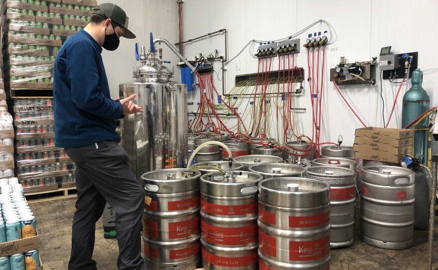 An employee at Second Chance Beer Co. in Carmel Valley cleans kegs of beer, Mar. 12, 2021.